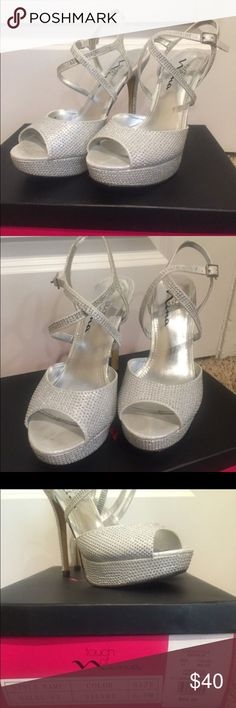 Silver heels Silver heels. Only worn once for a wedding. Great condition. Has small rhinestones on them Shoes Heels