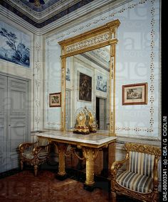 Red Salon characterized by gilded marble-topped piece of furniture in Empire style from the 1800s. Villa Durazzo Faraggiana, Albissola Marina, Italy, 19th century .