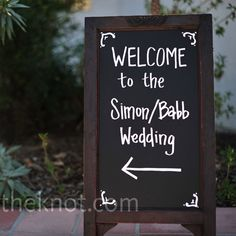 Have a sign outside lodge welcoming people to the wedding