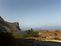 """Oliveri (ME) - La Riserva Naturale """"laghetti di Marinello"""", sulla sinistra la montagna affacciata sul mare sulla quale si trova il santuario di Tindari e sullo sfondo all'orizzonte l'isola di Vulcano   da Lorenzo Sturiale"""