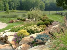 Close up view of hardscape planters incorporated into the design of this landscaped hillside.
