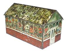 Far Famed Cake Co, a British biscuit tin in the shape of a greenhouse