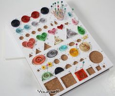 Quilling Circle Template Board. I ordered mine on EBay. Shipped from China. Couldn't find US or Canadian supplier.