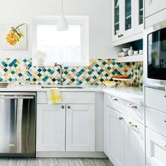 Sneak some pattern play into your kitchen with a colorful tile backsplash. Genius!