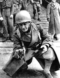 Liberation of France, 1944. A soldier of General Leclerc's French 2nd Armoured Division savours the moment as he sets foot on French soil in Normandy. (Photo by Art Media/Print Collector/Getty Images)