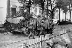 Soldiers from the 9. SS Panzer Division Hohenstaufen and StuG III's from Sturmgeschütz-Brigade 280 advance on the Utrechtseweg street in Arnhem, Netherlands in a mop up operation against British positions on 19 September 1944.