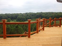 Cable Deck Railing Wood Posts This beautiful deck offers a clear view with a timeless, minimalistic appearance of wood posts and cable railing. The simple 3 step Atlantis Rail Easy Cable Railing System was used to achieve this look.