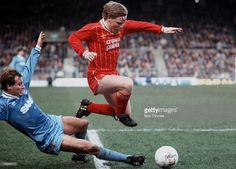 4th April 1983, Liverpool v Manchester City, Liverpool's pint sized forward Sammy Lee jumps over a challenge from Manchester City's Asa Hartford