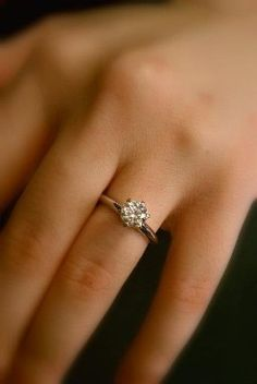 The perfect engagement ring: round diamond, six prong, platinum band. I love how small and simple it is.
