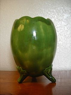 I love the leafy feet on this vintage vase I found at an estate sale, Etsy listing at https://www.etsy.com/listing/205226958/glazed-ceramic-vase-green-pottery-vase