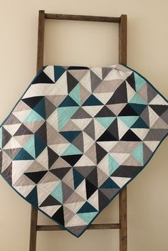 #ManQuilt craftyblossom: partly cloudy, a quilt. I like the use of varied grays with limited use of one 'more colorful' color in this HST quilt--great idea for a man's quilt.