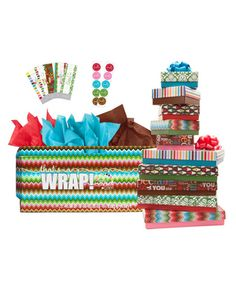 Gift Box Briefcase  From boxes and bows to tissue paper and stickers, this kit comes complete with the essentials for wrapping up ten cheerful gifts without any extra paper.    To buy: $69, erincondren.com.