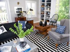 living room: black and white rug with gray and navy accents