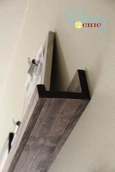 DIY picture ledge shelf. 3 pieces of wood, wood glue, and a drill. Boom!