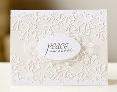 Memory Box die used down from the top and up from the bottom. Fills the card front. all white is always very pretty.