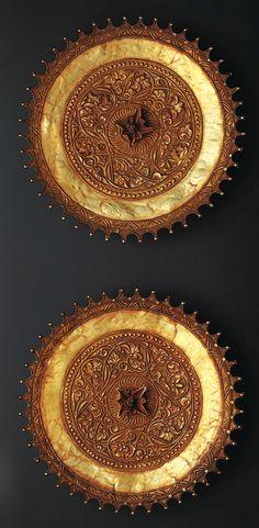 Indonesia ~ West Sumatra, Minangkabau | Ear discs with vegetal ornament | Gold | 19th century