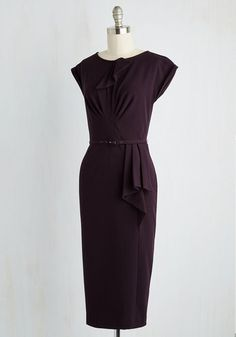 Declare your adoration for all things retro-fabulous with this deep purple wiggle dress by Stop Staring! It boasts such fetching features as draped and folded detailing at the neckline and skirt, and pretty pleating at the bodice, into the belted waist. Flaunt this cuff-sleeved piece as a going-out getup you'll love for years to come!