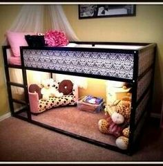 Bed on top, play room below. Nice idea for parents :)