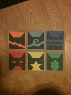 Made the Warrior Cat clan symbols with construction paper to use for decoration