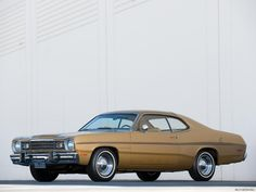 My parents had this car.  1973 Plymouth Gold Duster - Bing Images