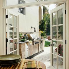 Large double doors create a seamless flow to this outdoor kitchen