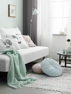 Beautiful combination of mint green walls, white furniture and grey accents.