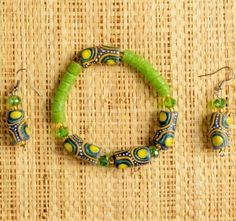 This bracelet and earring set is made with upcycled glass beads from Ghana, West Africa by a project that employs young woman who would otherwise be vulnerable to trafficking. Fair Trade.