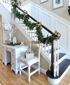 Make a boring stairway look like it's been there forever by adding molding and framing to the walls, and painting an accent color to the rest of the wall.