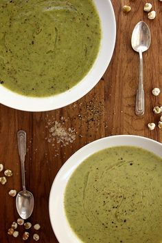 Creamy Zucchini Tarragon Soup serves 4 2 T olive oil 1 medium sweet yellow onion, about 1 1/2 cups 2 cloves garlic, peeled and minced  4 medium zucchini, chopped, about 5 cups 2 T fresh tarragon leaves, plus more for garnish 1/4 cup white wine 2 cups vegetable or chicken stock salt and fresh cracked black pepper 1/4 cup heavy cream, optional white truffle oil for garnish, optional