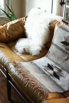 native woven throw and flokati throw on leather sofa // #textiles #boho #decor