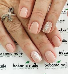 Simple nude nail art design with details on top in white polish. Keep your nails clean but pretty with nude polish and a bit of detail in white above your base color.