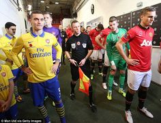 The Arsenal and Manchester United teams line up in the tunnel prior to kick off
