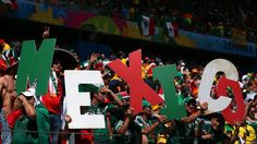 Mexico fans cheer during the 2014 FIFA World Cup Brazil Round of 16 match between Netherlands and Mexico at Estadio Castelao on June 29, 2014 in Fortaleza, Brazil.