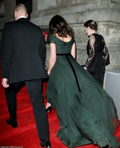 Making their ascent: From behind, she displayed a neat velvet black bow...