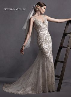 Elegant beaded embroidered lace sheath dress with glittering Swarovski crystals, Chavelle by Sottero and Midgley.