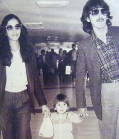Olivia Arias-Harrison, Dhani Harrison, and George Harrison (It's so cute to see Dhani holding both parents' hands toddling..adorable!)