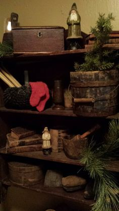 Prim Christmas...belsnickles and pine in an old cupboard.