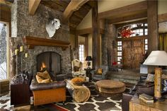 Open Country/Rustic Living & Family Room by Jerry Locati on HomePortfolio Love the log coffee table.