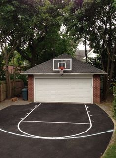 The whole family plays two-on-two in the driveway