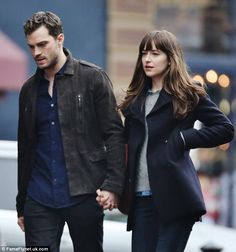 So happy together? Dakota Johnson and Jamie Dornan were seen holding hands this week on the set of Fifty Shades Darker in Vancouver, BC, Canada