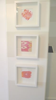 Love the framed fabric swatches