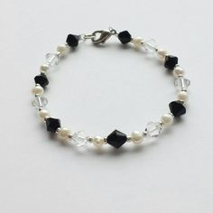 Check out this item in my Etsy shop https://www.etsy.com/listing/210048441/black-and-white-bracelet-with-swarovski
