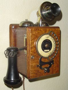 old wall phone. Loved the party lines.  Had to stand on a stool to reach it.