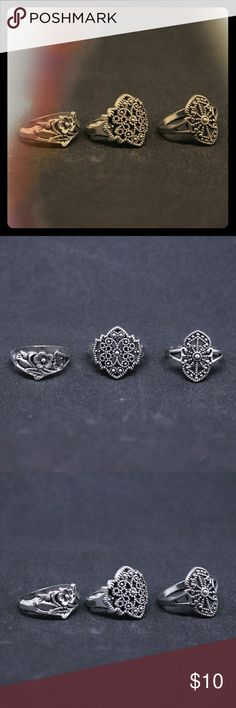 Flower Antique-style 3 Ring Set Silver Plated (b) A set of 3 Silver-plated fashion rings with a cool vintage style. All three rings are size 7 3/4 to 8. This is one of 5 set options in my closet, feel free to buy more than one set for a bundle discount!  -Flower ring -Antique Wheel ring -Vintage scrollwork ring none Jewelry Rings