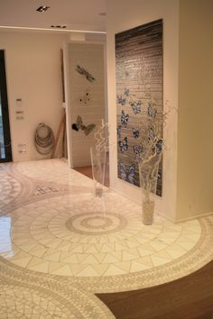 Pavimento intarsiato mosaico e ceramica.