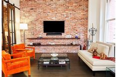 Living room of New York loft with exposed brick wall