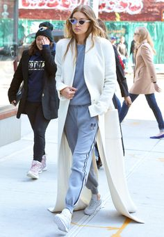 Gigi Hadid Dons a Sidewalk-Skimming White Coat in N.Y.C. from InStyle.com