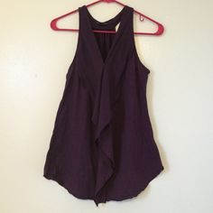 Banana Republic purple tank Perfect condition. Dark purple. Really cute layered look on front. Would be cute under a cardigan. 82% polyester 14% rayon 4% spandex Banana Republic Tops Tank Tops