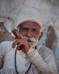 Portrait of a old man smoking chilam . I met Rabari Ramji Dada (old man) on the way to Bhuj. It was a small tea shop in village & he was in his traditional cloths of a semi-nomadic people call Rabari; known as Kedia (Shirt) and Chorni (pant). He was free for sometime and in relax mood after all hardwork done in his little farm and his herds were kept in shadow in hot sunny sun. #old_man #portrait #relax #india #kutch #travel #portrait #instaphoto #instagujarat #gujarat #lifestyle #leisure…