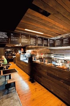 reclaimed wood counter front, hanging menu boards: